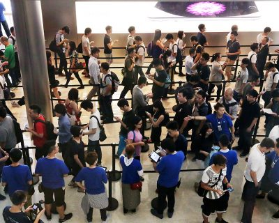 Customers waiting to buy  the iPhone 6 and iPhone 6 Plus outside the Apple store at IFC in Central. 19SEP14